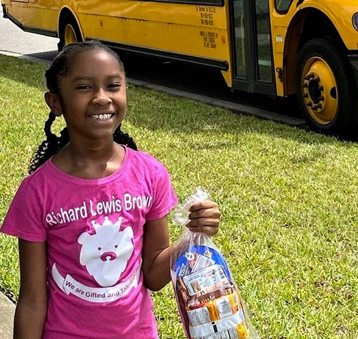 child holding prepacked food